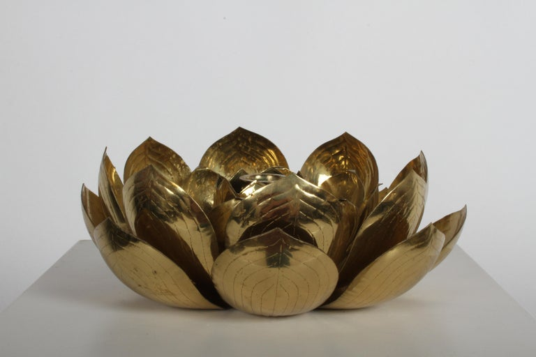 Single brass lotus flower candleholder, attributed to Feldman light company. Original patina to brass, has former owners info engraved into bottom and dated 1960.