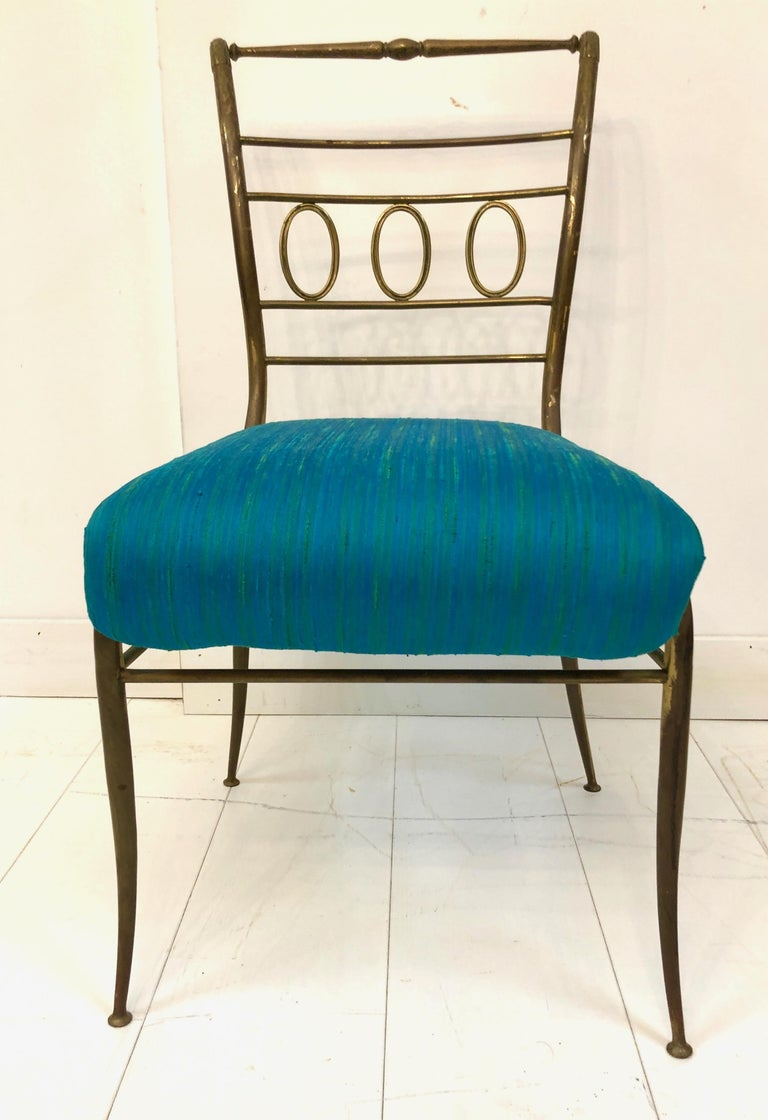 Beautifully sculptural solid brass side chair, with scroll detailing and original turquoise silk upholstery. Stamped