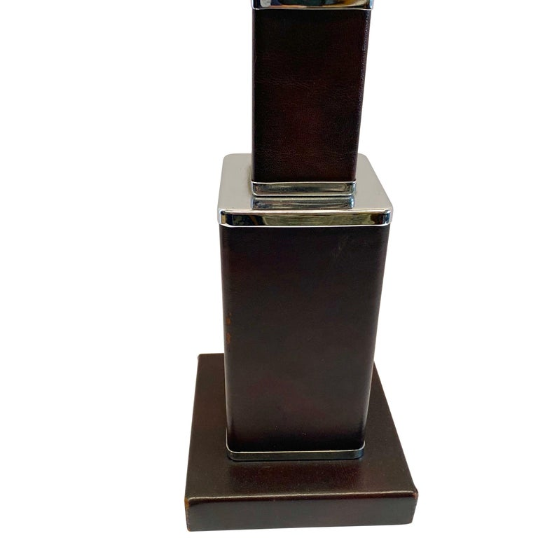 1970s French brown leather lamp with polished nickel trim. Stacked graded size cube design. Two sockets for standard bulb. Newly rewired Measures: Overall height of lamp base 22