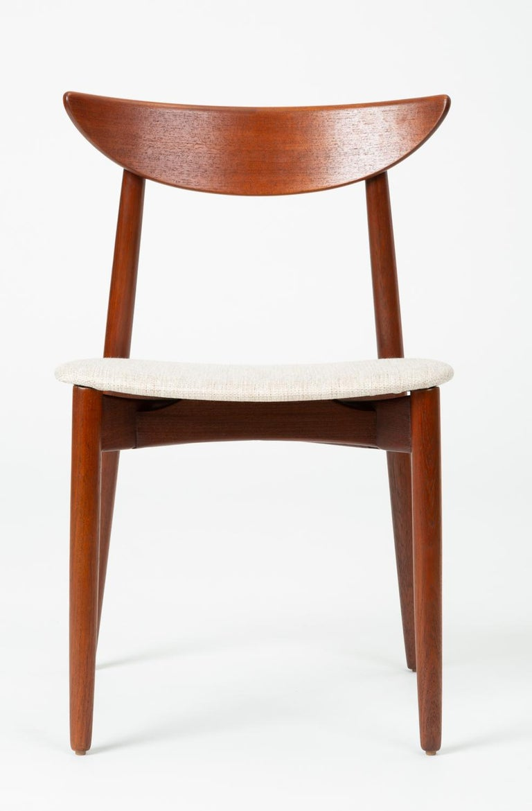Designed circa 1960 by Harry Østergaard, this desk, dining or accent chair was manufactured in Denmark by Randers Møbelfabrik. The chair was imported, like many other Randers designs, by the Long Beach-based Moreddi for sale in their partner