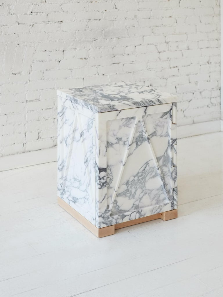"""A part of Fort Standard's collection, """"Qualities of Material"""", this single door stone cabinet has a triangular relief pattern milled into the exterior panels, which removes excess weight and allows the remaining ribs to retain the material's"""