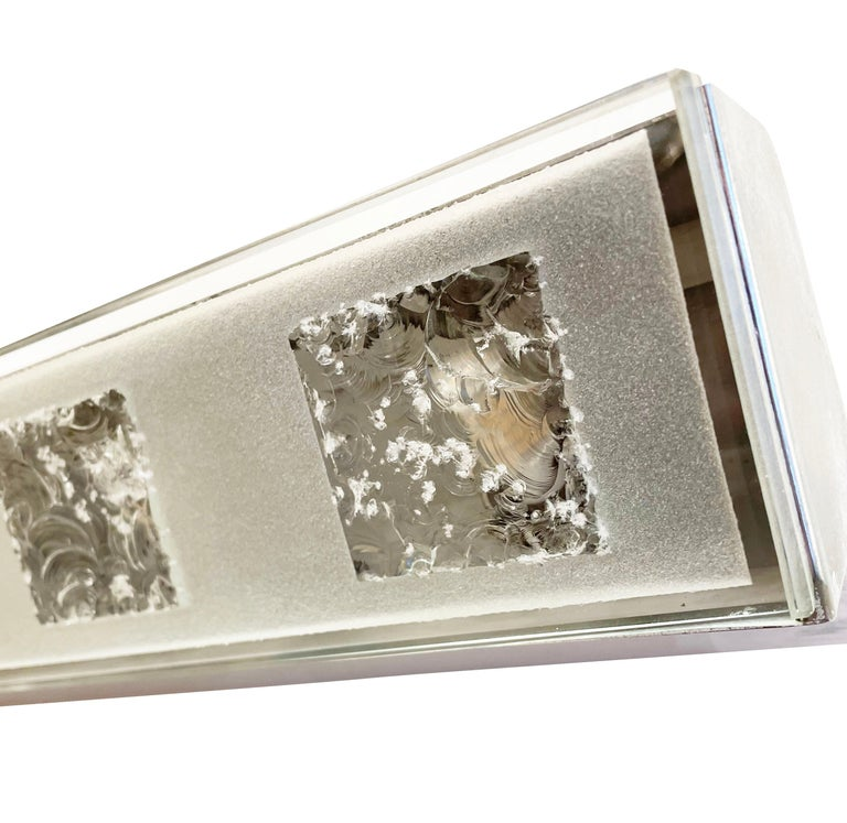 Elongated wall light by Max Ingrand for Fontana Arte featuring a frosted glass shade with five chiseled squares. The chrome frame holds five candelabra bulbs.  Condition: Excellent vintage condition, minor wear consistent with age and use