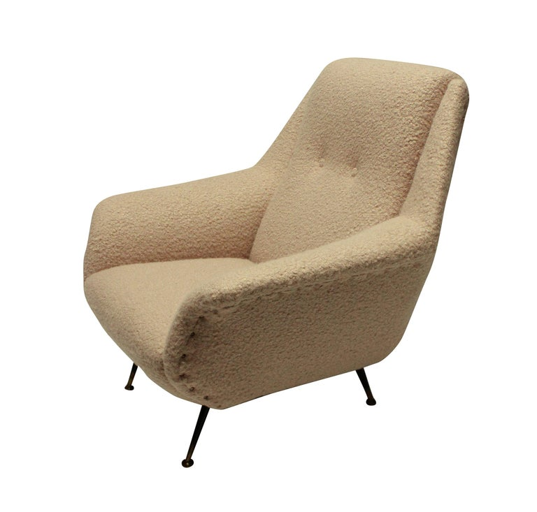 An Italian armchair by Gio Ponti. Newly upholstered in Designers Guild's Baluchi, a dusty pink lamb's wool.