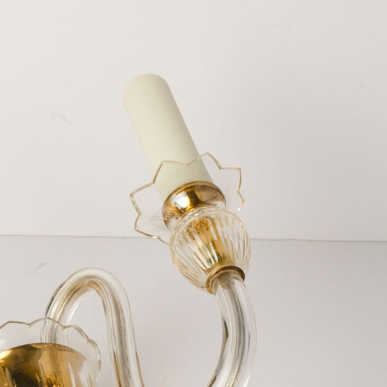 Single Murano two-arm sconce newly wired for use within the USA. Vintage clear glass sconce includes back plate.