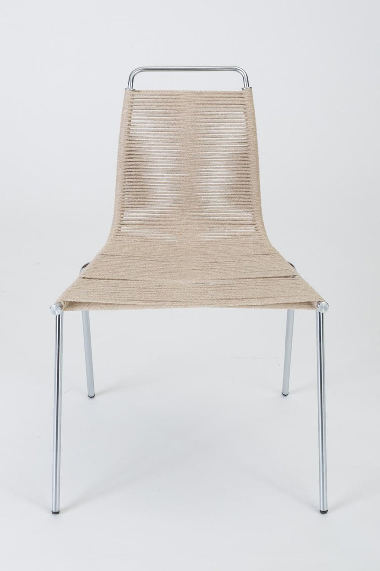 A single side or accent chair designed by Poul Kjærholm for E. Kold Christensen in 1955. Originally, the series PK-1, -2, and -3 referenced a complete line of steel-frame chairs with the seat material indicated by the model number (1 is done in