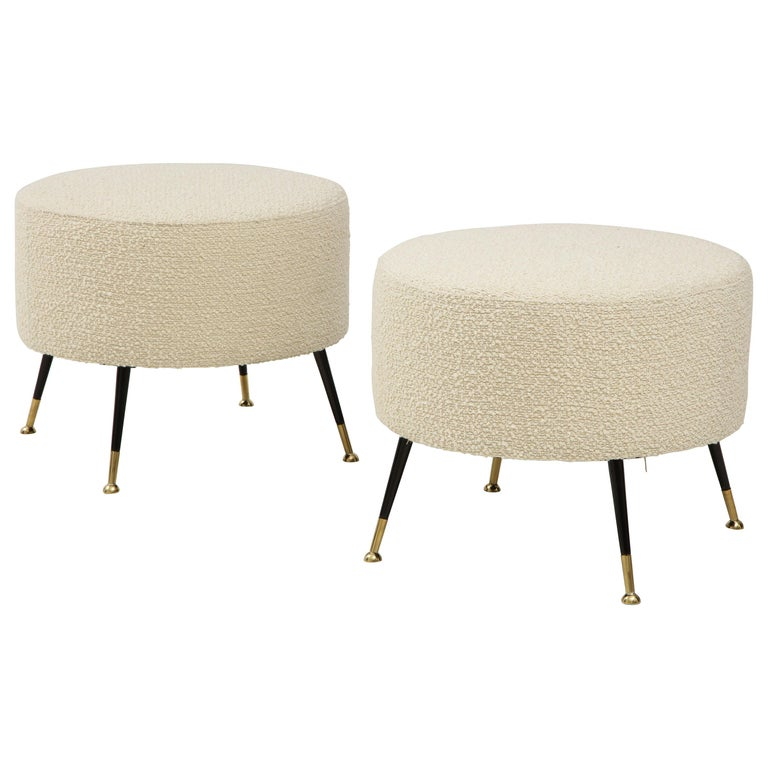 Single round stool or pouf was hand made in Florence, Italy, by a master furniture artisan. Round seat in imported Ivory Boucle fabric with black enamel and brass legs. This stool or pouf is on display at the Gallery at 200 Lex at the New York