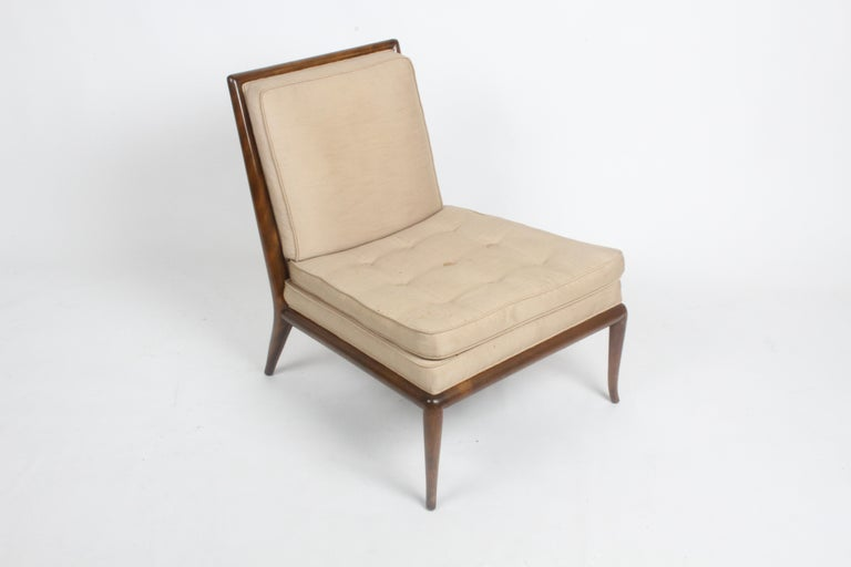 Beautiful design by T. H Robsjohn-Gibbings in original finish, with older silk upholstery. Elegant splayed legs on walnut frame, original finish shows minor scuffs. Upholstery shows stains, needs to be updated. From one owner estate, no label, home