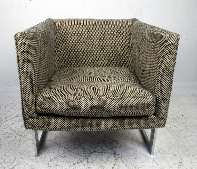Mid-Century Modern Milo Baughman armchair featuring a unique upholstered seat, chrome frame.  Please confirm the item location (NY or NJ).