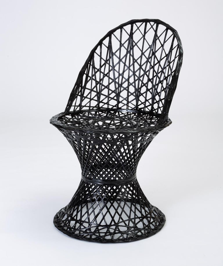 A single dining side chair by Russell Woodard from his family company, Woodard Furniture's popular spun fiberglass patio collection. The design features an hourglass shape and rounded seat. The chair frame is described by an intricate lattice of