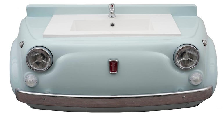 Sink model Michelle 01 is an original design artwork realized by Michele Di Gregorio in 2019.  This unique work was realized with a grille of a vintage car Fiat 500, modified with a hand-wrought ten-tenths metal sheet. The piece comes with a