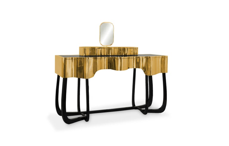 Sinuous is a dressing table designed with a modern and glamorous touch perfect for your bedroom or master bathroom set. Produced in wood, it is covered in a black high gloss varnish and polished brass. It offers a lot of storage space, with four