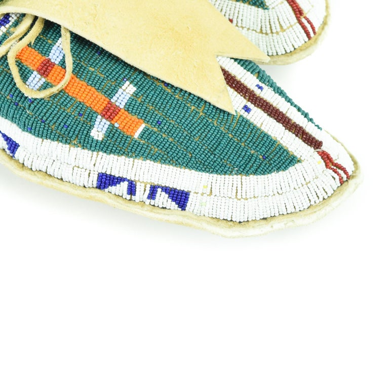 Sioux moccasins with buffalo hoof design, faceted beads in center stripe, soft soles. 11