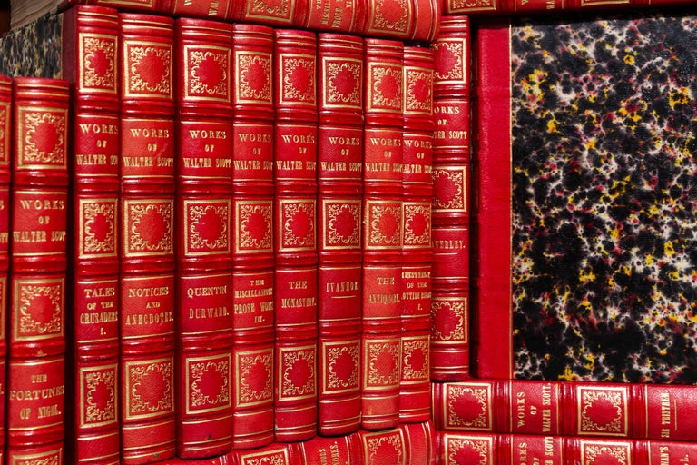 43 volumes. Sir Walter Scott. Waverley Novels. Bound in 3/4 Red Morocco, marbled Boards and Edges, Raised bands, ornate gilt on spines. Published: Paris: Baudry 'S European Library 1838. Handsome set