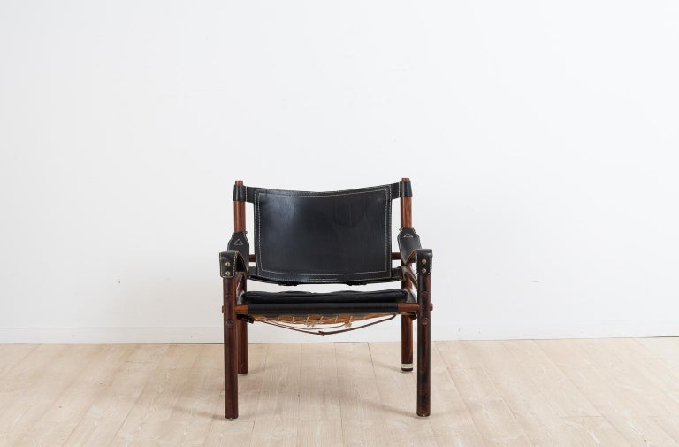 Scandinavian Modern Sirocco Safari Chair in Black Leather by Arne Norell  For Sale