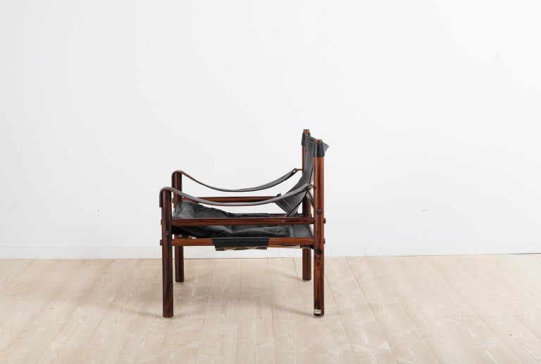 Swedish Sirocco Safari Chair in Black Leather by Arne Norell  For Sale