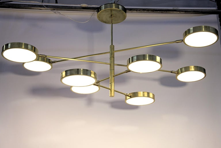 Patinated Sistema, Brass 8 Rotating Orbitale Arms Chandelier, Featured for Dining Table For Sale