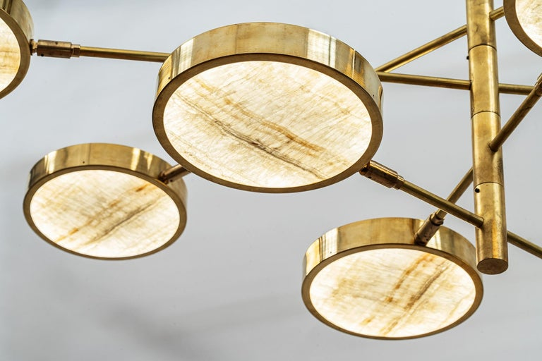 Sistema Solare is the variation of the Sistema chandelier where the shade is made of a thin cut Ivory Onyx slab. Actually the whole project started for this incredible material. Ivory Onyx comes from middle east quarries and has an unique veining. I