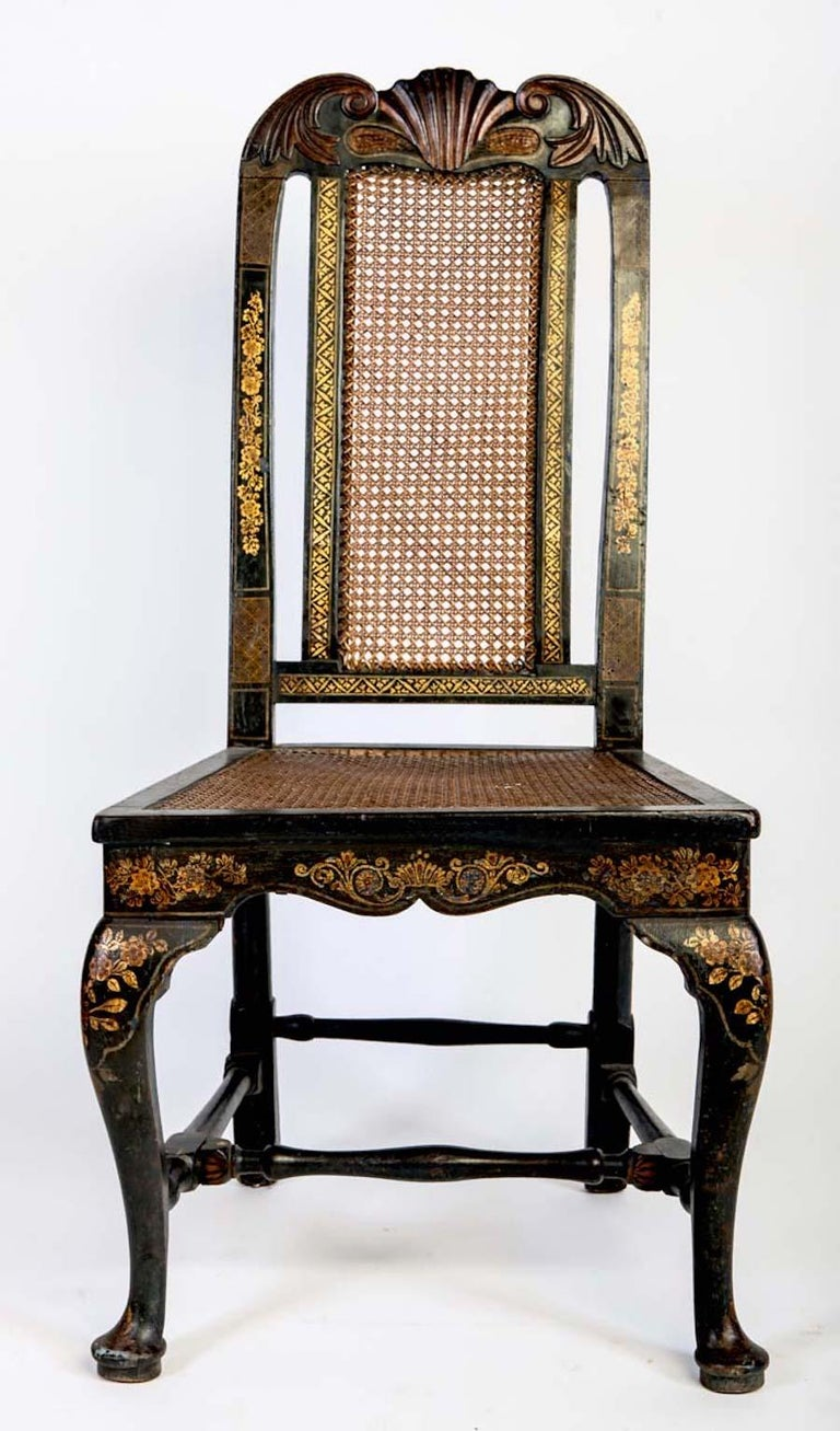 A fine set of six English 18th century blue painted and parcel-gilt chairs with vase shaped back splats and caned seats, over cabriolet legs with pad feet.