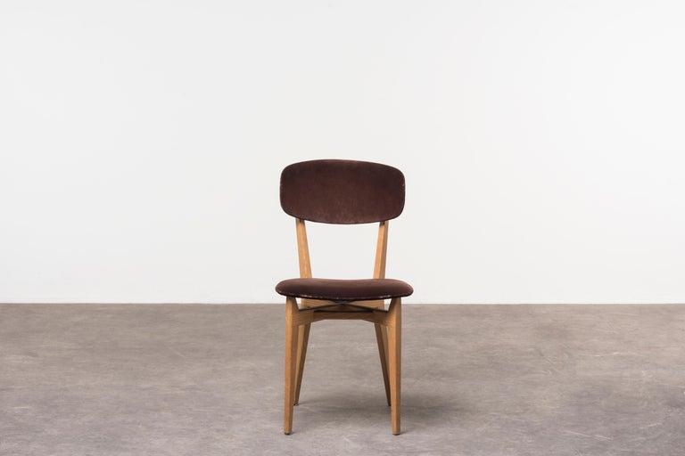 Six 691 chairs by Ico Parisi Italy, 1955. Realized by Cassina. Ash wood, velvet upholstery. Special mention at Compasso d'Oro, 1955. Literature: Repertorio del Design Italiano 1950-2000 per l'arredamento domestico by G. Gramigna, Umberto Allemandi
