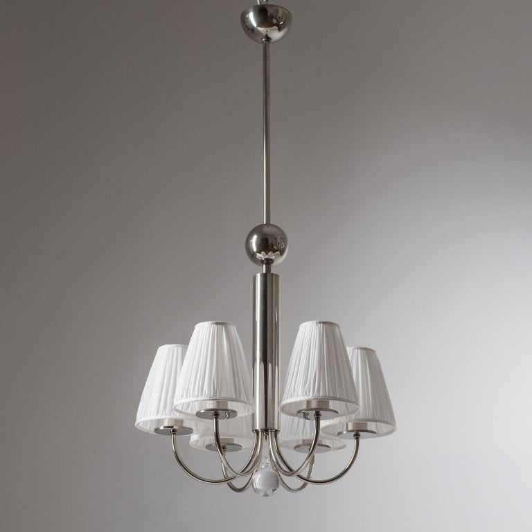 Rare six-arm Bauhaus chandelier, circa 1928. Nickeled brass hardware with a large glass