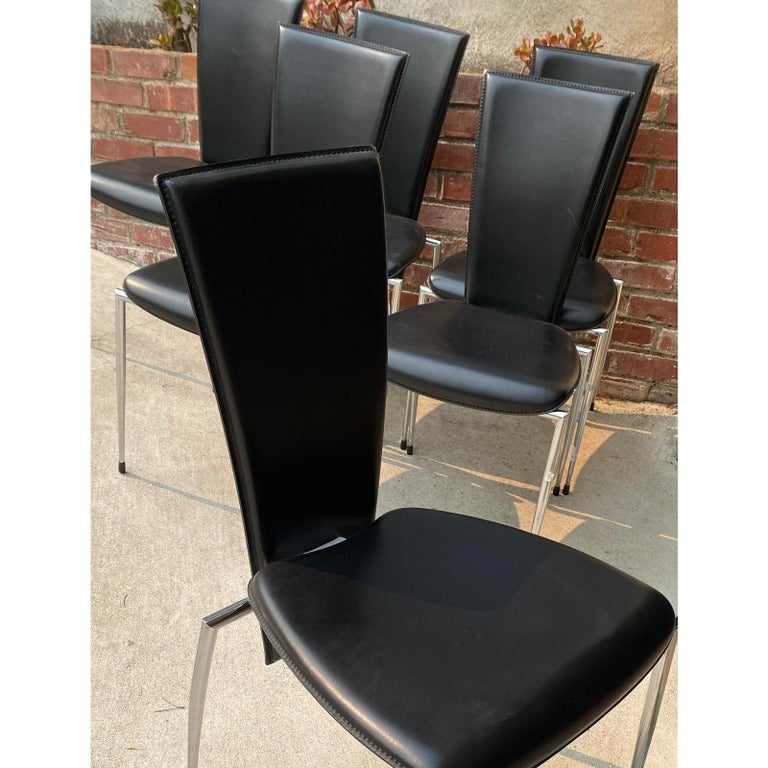 Sixblack leather and chrome Italian modern dining chairs by Arper  Quality built. Made in Italy. Gorgeous dining chairs.  Measures: 17.5