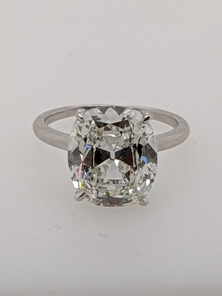 Six carat Classic Antique Style Cushion Cut Diamond Ring in a temporary Platinum Solitaire mounting (which is included with this diamond free of charge or good toward a custom made mounting).  This extraordinary featured diamond is a 6.16 carat H