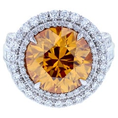 Six Carat Fancy Deep Orange Yellow Diamond Ring with Triple Shank & Diamond Pave