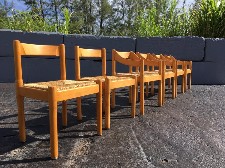 """Four armchairs and two side chairs. Side chairs are 19"""" deep and 20"""" wide. Solid birch with rush seats. Chairs have wear but are still great."""