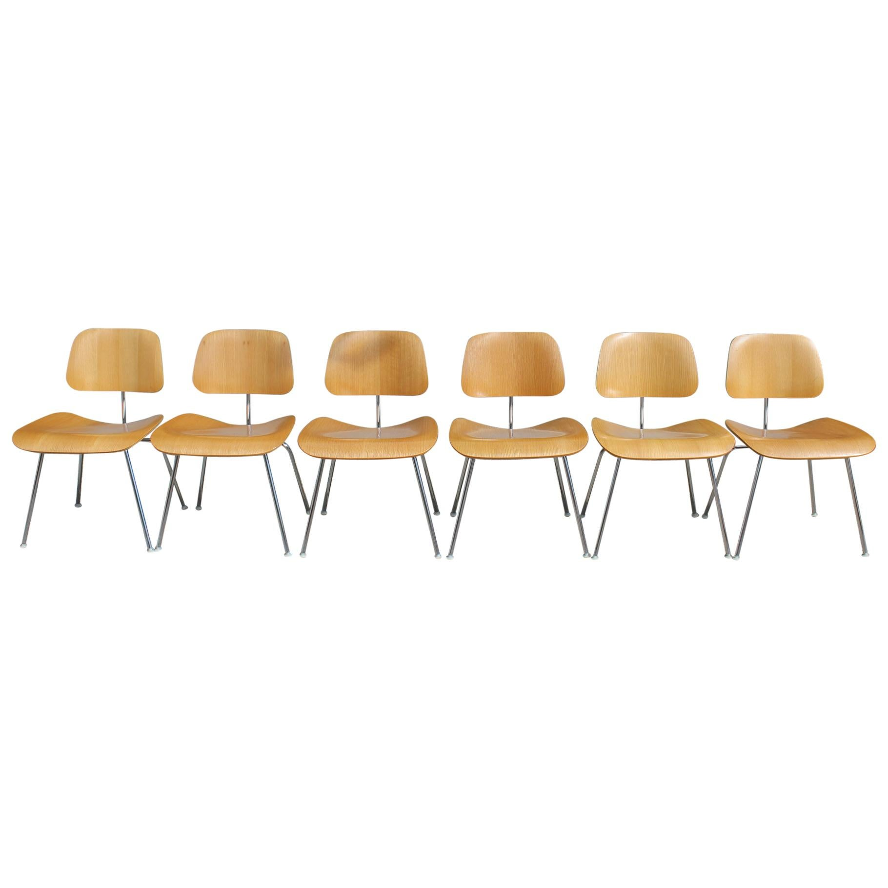 Six Charles and Ray Eames DCM Chairs