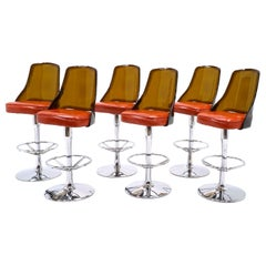 TWO AVAILABLE. of Chrome and Amber Lucite Bar Stools with Orange Vinyl Seats.