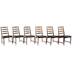 Six Danish Modern Rosewood Ladder Back Dining Chairs by Arne Vodder, Black Seats