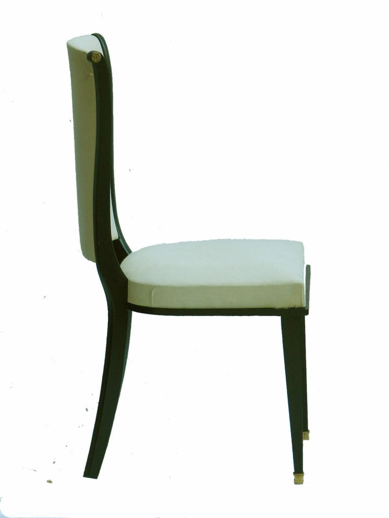 Six dining chairs Art Deco Empire revival French, circa 1940-1960 Mid Century manner of Andre Arbus  Upholstered and ebonised wood With brass feet and side roundels These will be sent covered to 'calico' undercovers ready for top covers  Or if you