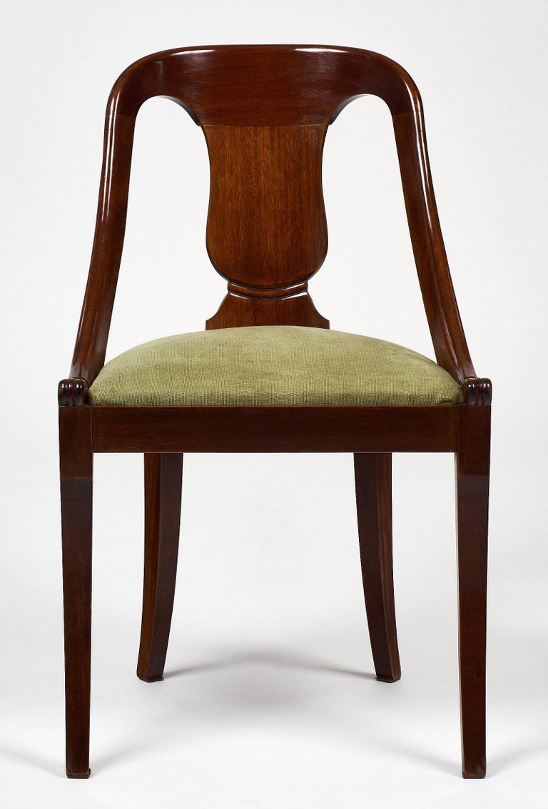 """Fine set of six French Empire style """"gondola """"chairs, with hand-carved frames, each finished with a lustrous hand-rubbed French polish. The chairs feature elegant neoclassic lines in the purest Empire style. The seat is upholstered with its original"""
