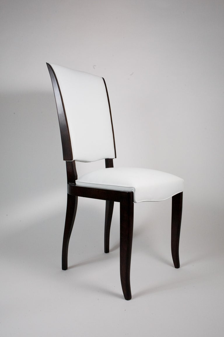 Set of six French rosewood Art Deco dining chairs upholstered in white Spinney back leather. Great lines and elegant design.