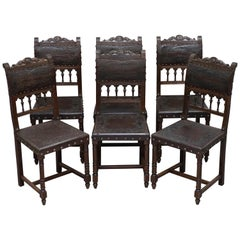 Six Henry II circa 1880 French Oak and Embossed Crocodile Leather Dining Chairs