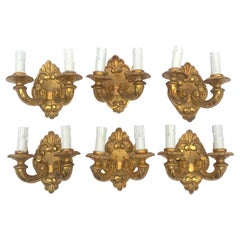 Six Italian Gilded Sconces Six Giltwood Two-Armed Wall Lights, 19th Century