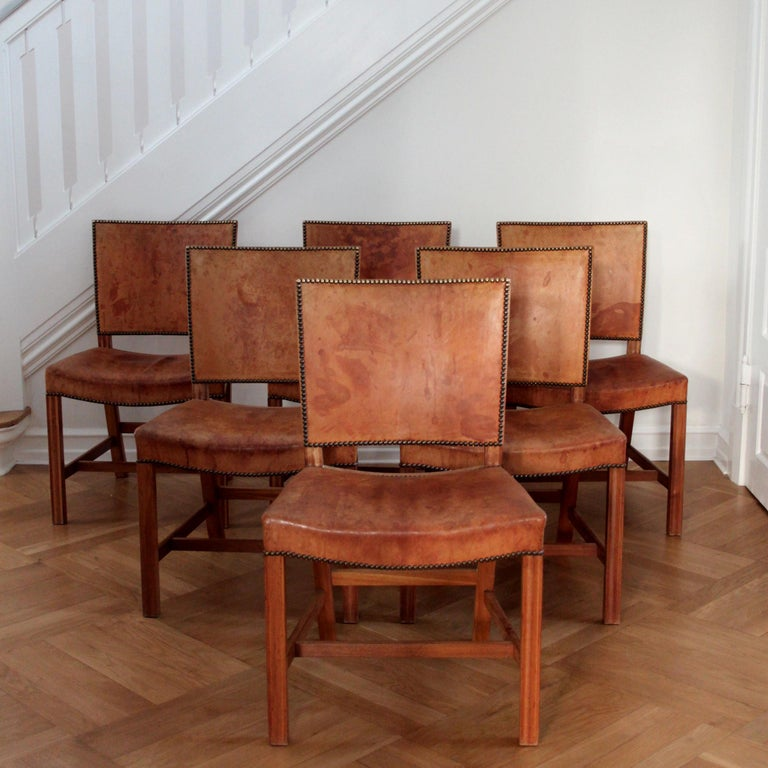 KAARE KLINT & RUD RASMUSSEN  - SCANDINAVIAN MODERN  A beautiful set of six Kaare Klint 'Red Chair' or 'Barcelona Chair' by Kaare Klint with deep patina in original Niger leather, profiled legs of mahogany and brass nails.  These examples made circa
