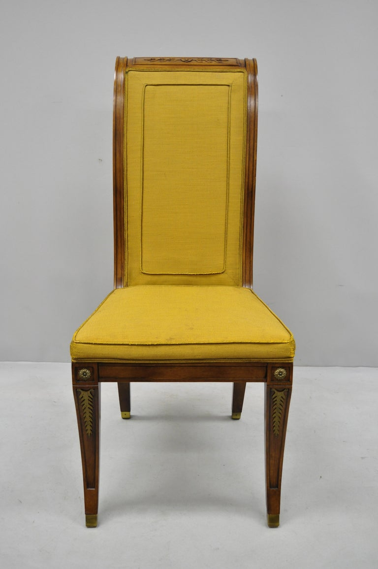 Six Karges French neoclassical Regency style Klismos leg walnut dining chairs. Listing includes 2 armchairs, 4 side chairs, bronze ormolu, solid wood construction, nicely carved details, original label, shapely saber legs, sleek sculptural form,