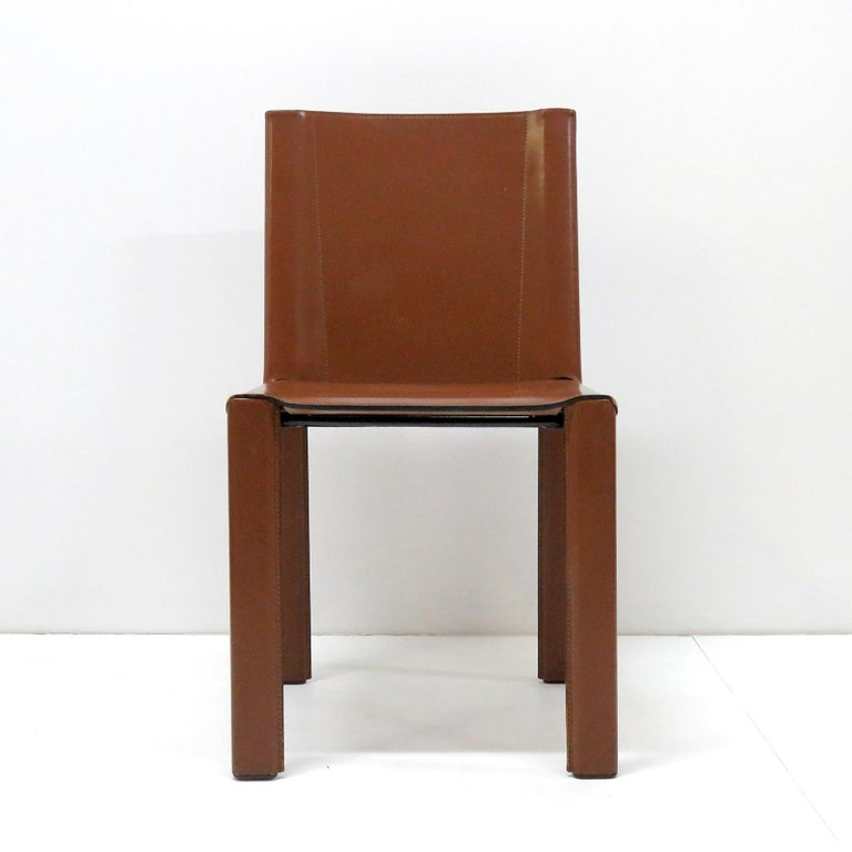Elegant 'Coral' dining chairs designed and manufactured by Matteo Grassi, Italy, 1980, steel frames wrapped in cognac colored leather in very good condition. Five chairs plus one chair with arm rests available.