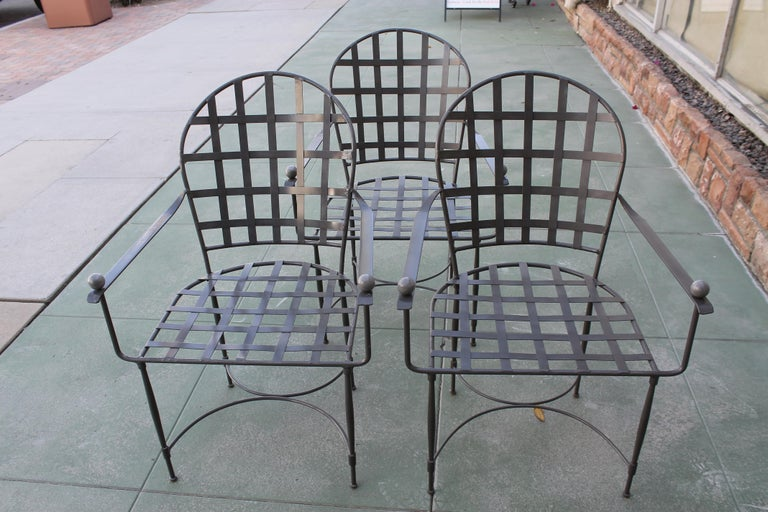 """Six patio chairs by Mario Papperzini for Salterini. Chairs have been sand blasted and powder coated to a grey clear coat. Each steel chair with aluminum ball finials measure 25.5"""" wide, 25"""" deep and 36"""" high. Seat height is 16.5""""."""