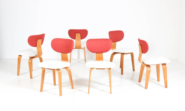 Stunning and rare set of six Mid-Century Modern Combex Series SB02 dining chairs. Design by Cees Braakman for UMS Pastoe. Striking Dutch design from the 1950s. Birch plywood frames and re-upholstered with two-tone fabric. Marked with original