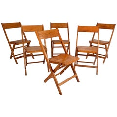 Six Mid-Century Modern Oak Folding Chairs by Snyder Chair Co.