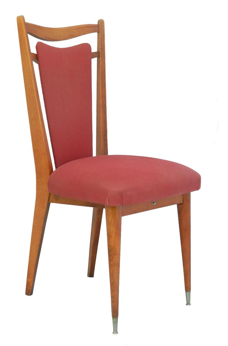 Six dining chairs midcentury French, circa 1970 Makers label  Superb shape  Upholstered and covered in red fabric if you would like a quote to do this please ask for details  Unusual system for removing seat for recovering In overall good condition