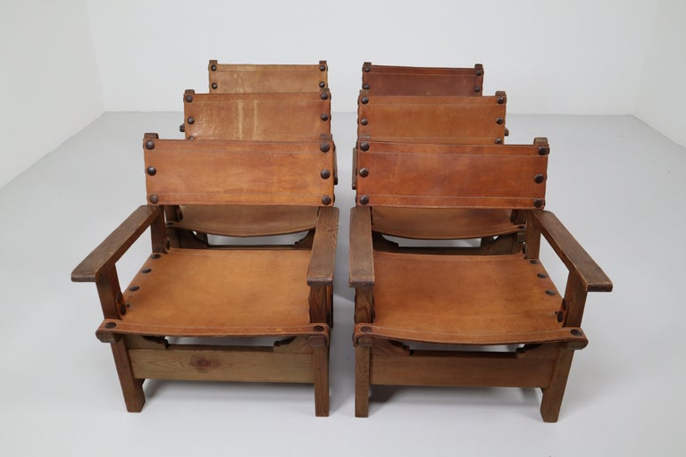 French Provincial Six Midcentury French Lounge Chairs in Patinated Cognac Saddle Leather, 1950s For Sale