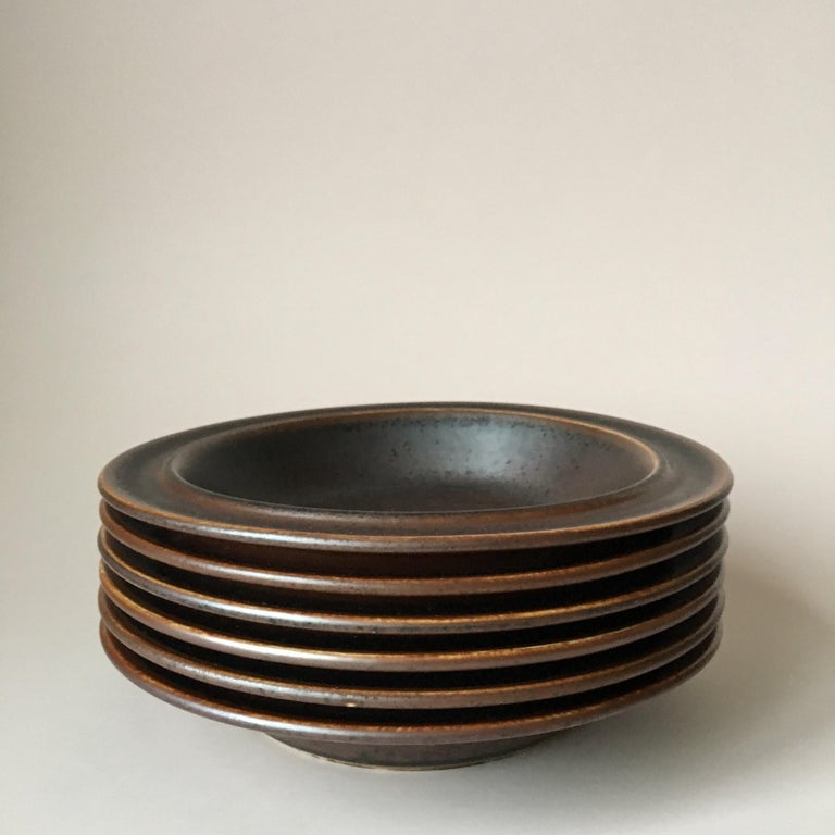 Ulla (Ulrika) Procope (1921-1968) worked in Arabia's art department from 1948 till 1967. She designed Arabia line in 1960s. It was the first time Arabia had used a matte glaze for mass produced utilitarian ware. It's composition is very tough and