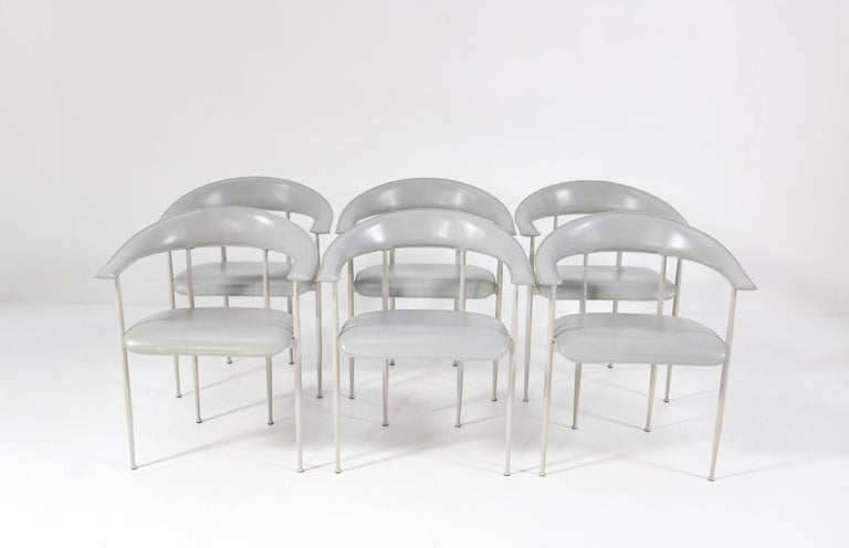 Wonderful vintage set of six P40 armchairs. Design by Giancarlo Vegni and Gualtierotti for Fasem. Striking Italian design from the 1980s. Lacquered metal frame with grey leather upholstery. Marked with manufacturers mark underneath the seat. In