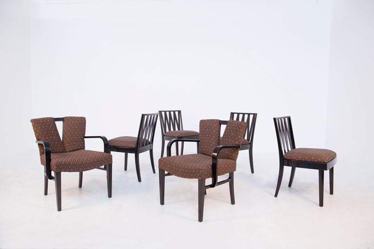 Wonderful set of six dining chairs in finely ebonized wood and fabric, designed by Paul Frankl (1886 - 1958) for Johnson Furniture and distributed by John Stuart in 1950. Paul Frankl initially known for his