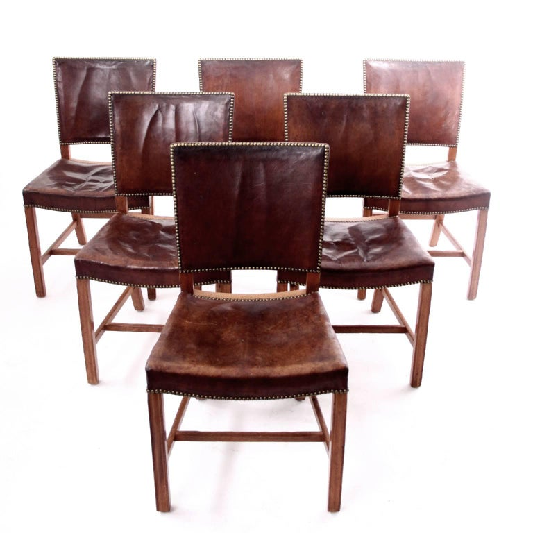 KAARE KLINT & RUD RASMUSSEN SNEDKERIER  -  SCANDINAVIAN MODERN  A set of six very early Kaare Klint 'Red Chairs', small model, all from the same provenance, hence same level of patina.    Profiled legs of mahogany, seat and back upholstered with