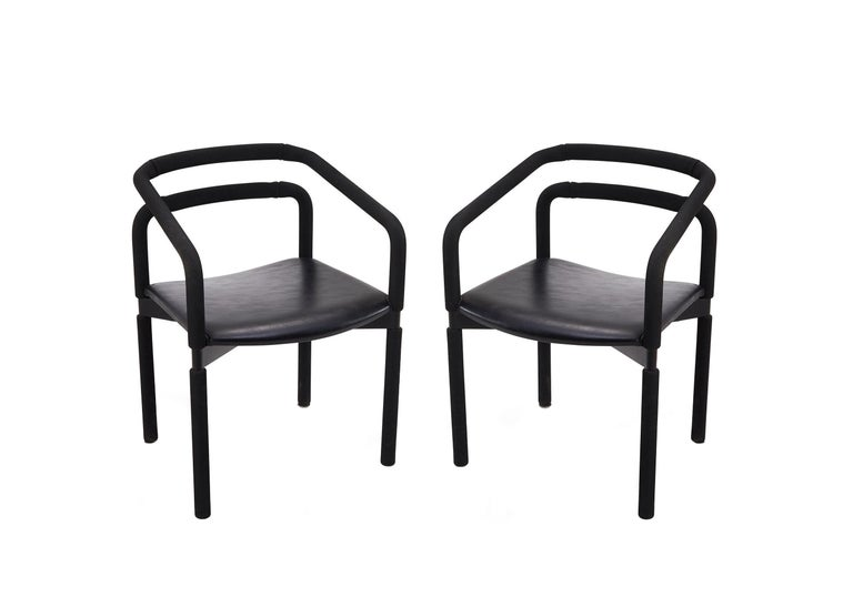 Fabulous set of six bold black armchairs by Metro for Steelcase designed by Brian Kane. These sleek vintage chairs are made of black steel encased in EPDM rubber tubing with comfortable black leather seats and offer a satisfying grip. In good ready