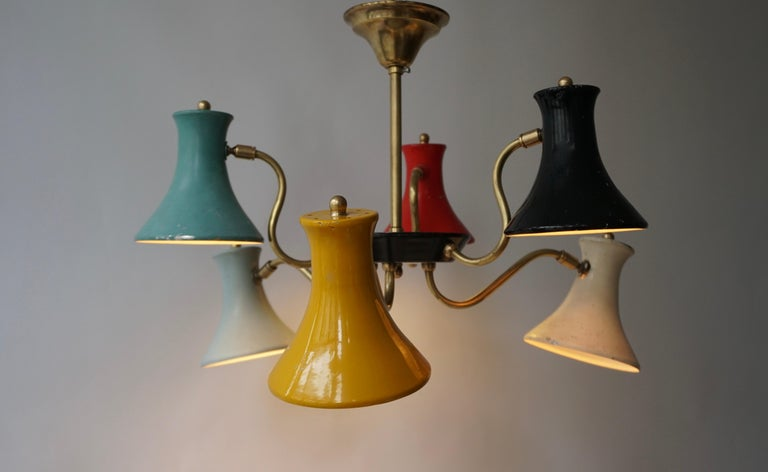 True Italian piece of design from the 1950s. Industrial lighting design with the use of vibrant colors.  This pendant has six uplighting shades.